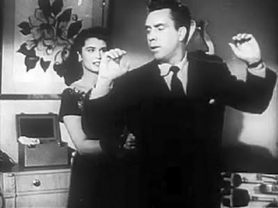 Marla (Laurette Luez) gives Frank Bigelow (Edmond O'Brien) trouble in D.O.A.