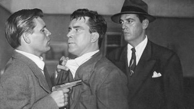 Chester (Neville Brand) gives Edmond O'Brien some more trouble. O'Brien is definitely not having a good day.