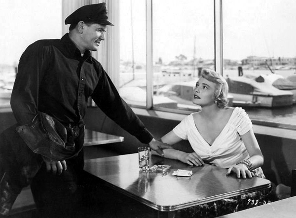 "John Garfield and Patricia Neal star in ""The Breaking Point."""