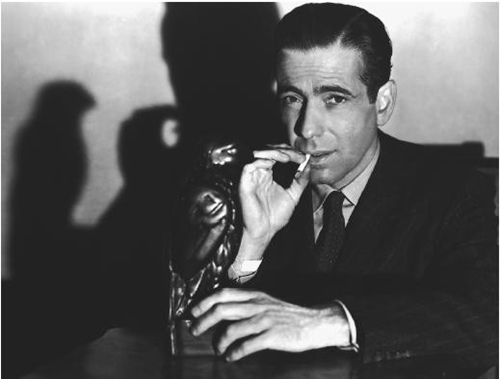 "As Raymond Chandler  put it: ""All Bogart has to do to dominate a scene is to enter it."""