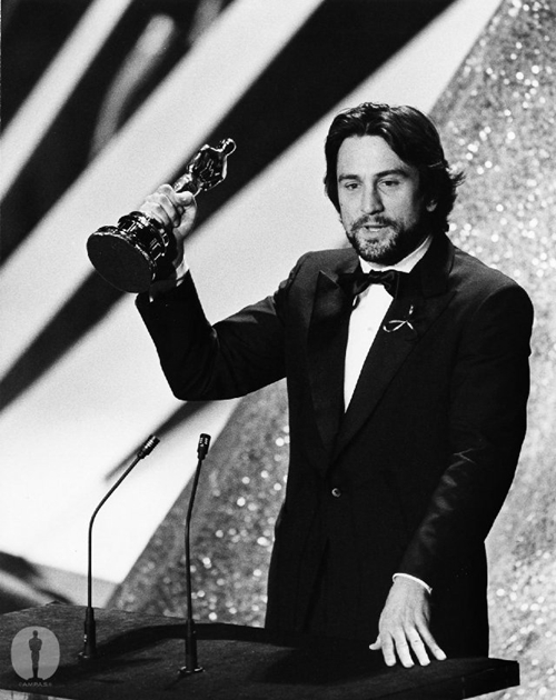 "Robert DeNiro gives accepts his Best Actor Oscar for ""Raging Bull"" (1980) directed by Martin Scorsese, who grew up on classic noir and became a neo-noir master. The oft-subbed Scorsese finally won the directing gold for 2007's ""The Departed."""
