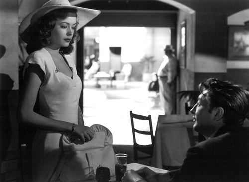 Robert Mitchum falls hard for Jane Greer and, baby, he doesn't care.