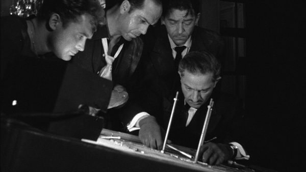 Jules Dassin's 'Rififi,' a heist film set in Paris, is a cinematic masterpiece.