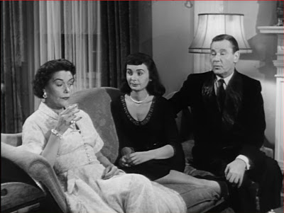 Diane and her Daddy (Herbert Marshall) enjoy loafing around their roomy mansion. Dad's second wife Catherine (Barbara O'Neil) foots the bill.