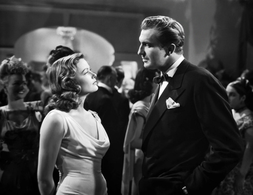 """Gene Tierney and Vincent Price size each other up in Otto Preminger's """"Laura."""""""