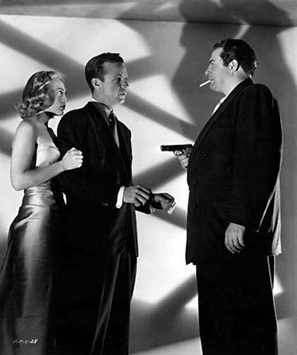 "Dick Powell and Lizabeth Scott face Raymond Burr in ""Pitfall."""