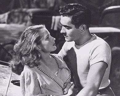 "Tyrone Power and Coleen Gray star in ""Nightmare Alley."""